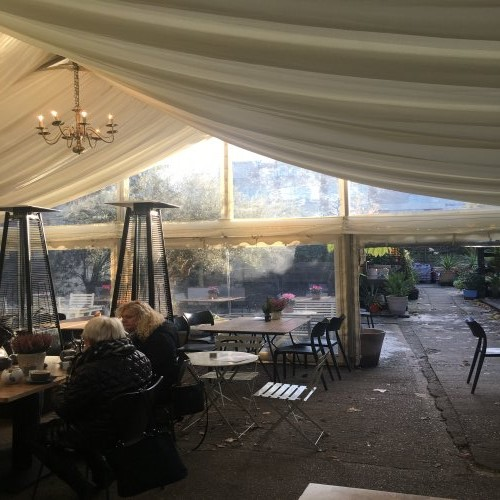 Marquee heaters used for outdoor seating in a cafe