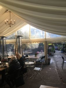 W6 garden centre cafe inside of marquee seating with people
