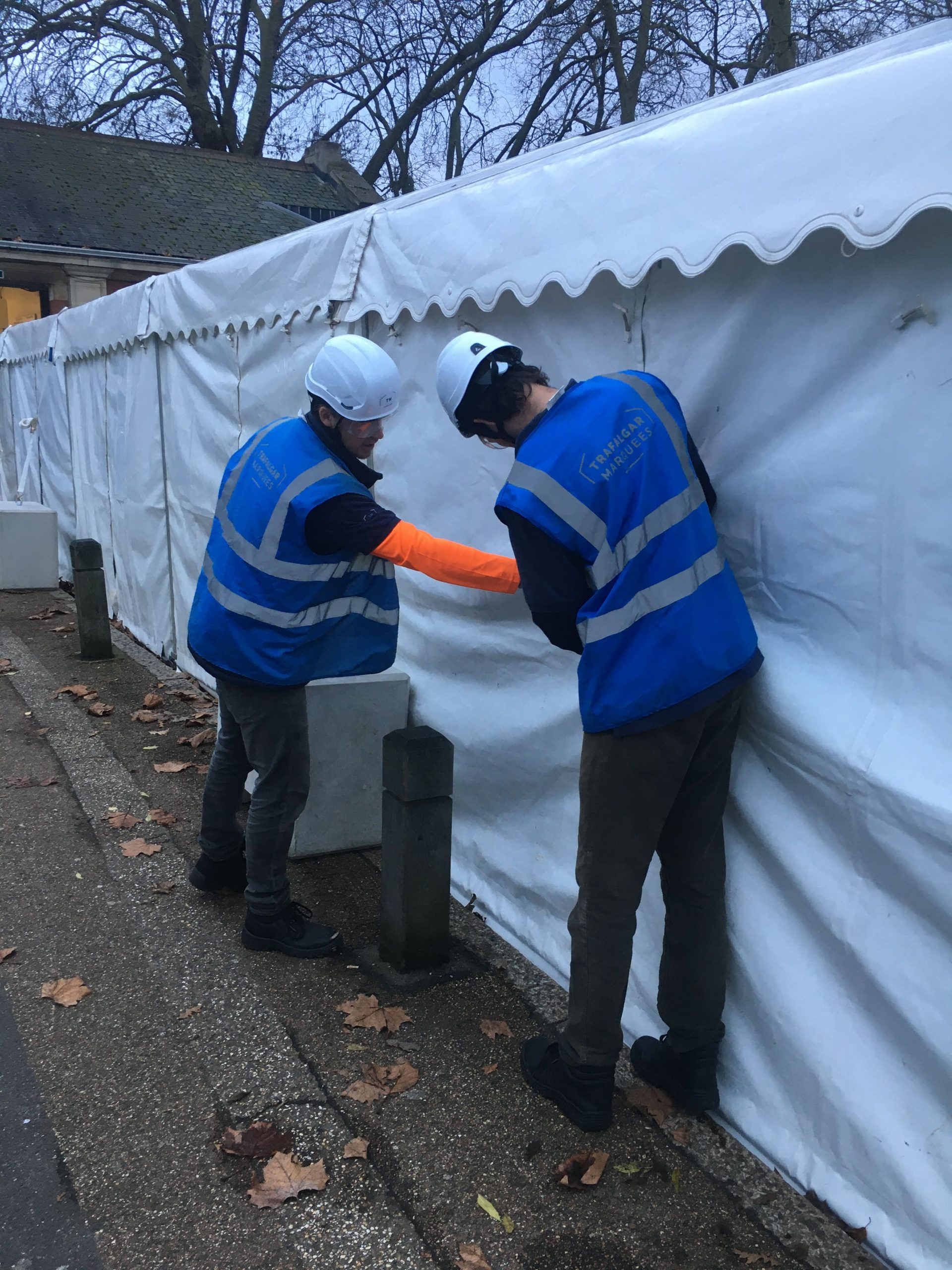 team members checking the safety of a marquee for an article about weatherproofing your construction site