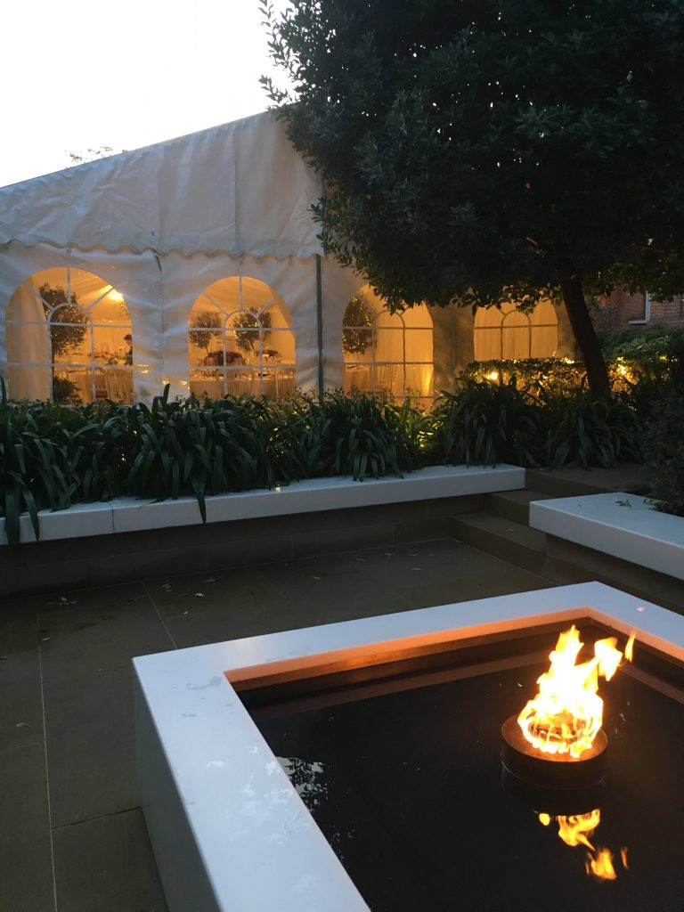 Evening marquee setting with firepit
